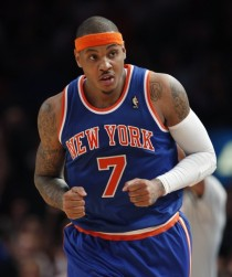 New York Knicks' Anthony after scoring a basket during first NBA game with Knicks against the Bucks in New York